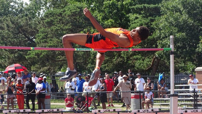 Mansfield Senior's Joe Ellis clears the bar to win the state title in the high jump during the Division I state track meet at Jesse Owens Memorial Stadium.