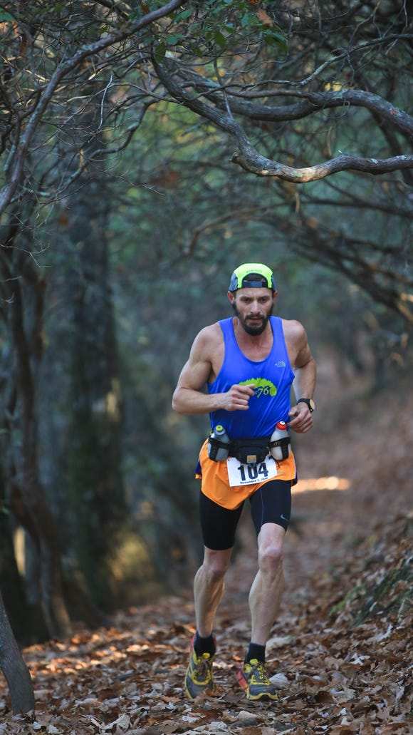Runners participate in the Shut-In Ridge Trail Race, held Saturday morning.  The race is 17.8 miles, from the Arboretum to Mount Pisgah.