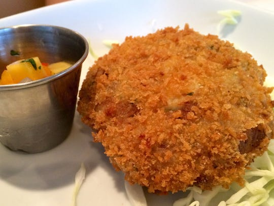 A panko-crusted Pine Island blue-crab cake is served