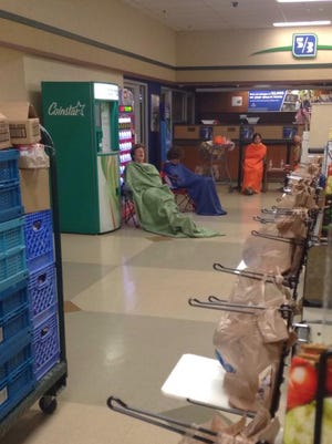 People settle in at Kroger during a five-hour lockdown.