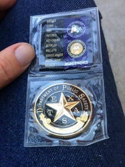 Zachary Dearing received a Challenge Coin from the State Troopers.