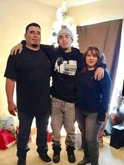 Joe Perez, center, was one of four people killed in