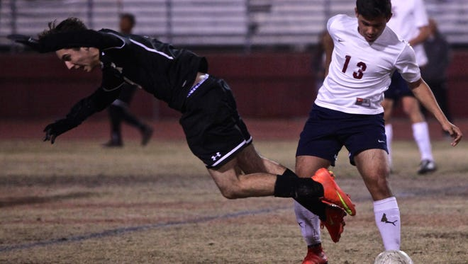 La Quinta's Isaac Briones (13) tackles Xavier Prep's Marcelo Lopez (9) during a home match on Thursday.