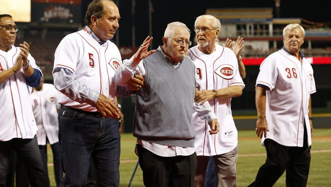 Enquirer file Reds Hall of Famers Johnny Bench, left, and Tommy Helms honored clubhouse manager Bernie Stowe at GABP in 2014.