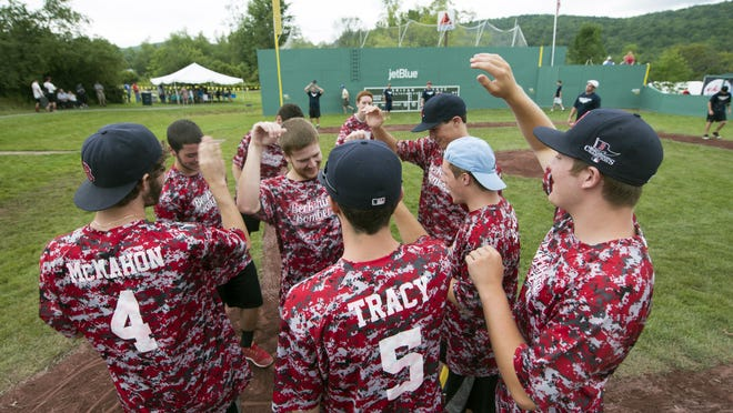 Jerry McDoungh, playing for team Bershire Bombers, is congratulated by teammates as he crosses the plate after hitting a home run during the 14th annual Travis Roy Foundation wiffle ball tournament at Little Fenway on Saturday in Essex.