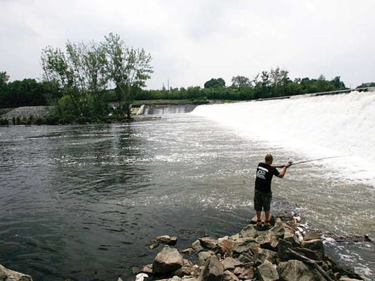 Pollution is so bad in the Passaic River that officials say no one should eat fish caught from the waterway. But that does not deter some anglers. To the right is the Dundee Dam, a barrier that prevented harmful dioxin from moving upriver.