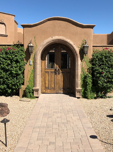 Larry and Rose Mary Winget like to decorate their Paradise Valley home with rough-hewn woods, stone and tile. Their home is a combination of textures and a mix of Western and Mexican styles with Moroccan accents, from the warm hacienda feel to the Saltillo floors.