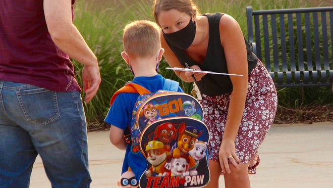 A teacher from Bentheim Elementary speaks with a student ahead of the first day of school Wednesday, Aug. 26.