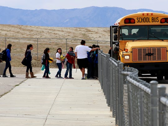 Students line up to catch the bus on Thursday at Nizhoni Elementary School in Shiprock.
