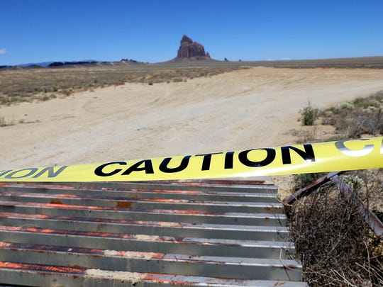 An access road to the Shiprock pinnacle area is taped off along Navajo Route 13 south of Shiprock on Tuesday. The site is a few miles from where 11-year-old Ashlynne Mike's body was discovered.