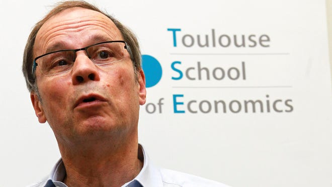 French economist and Nobel Prize laureate Jean Tirole addresses the media during a press conference at the Toulouse School of Economics in Toulouse, southern France, Monday, Oct. 13, 2014. Tirole won the Nobel prize for economics Monday for research on market power and regulation that has helped policy-makers understand how to deal with industries dominated by a few powerful companies.