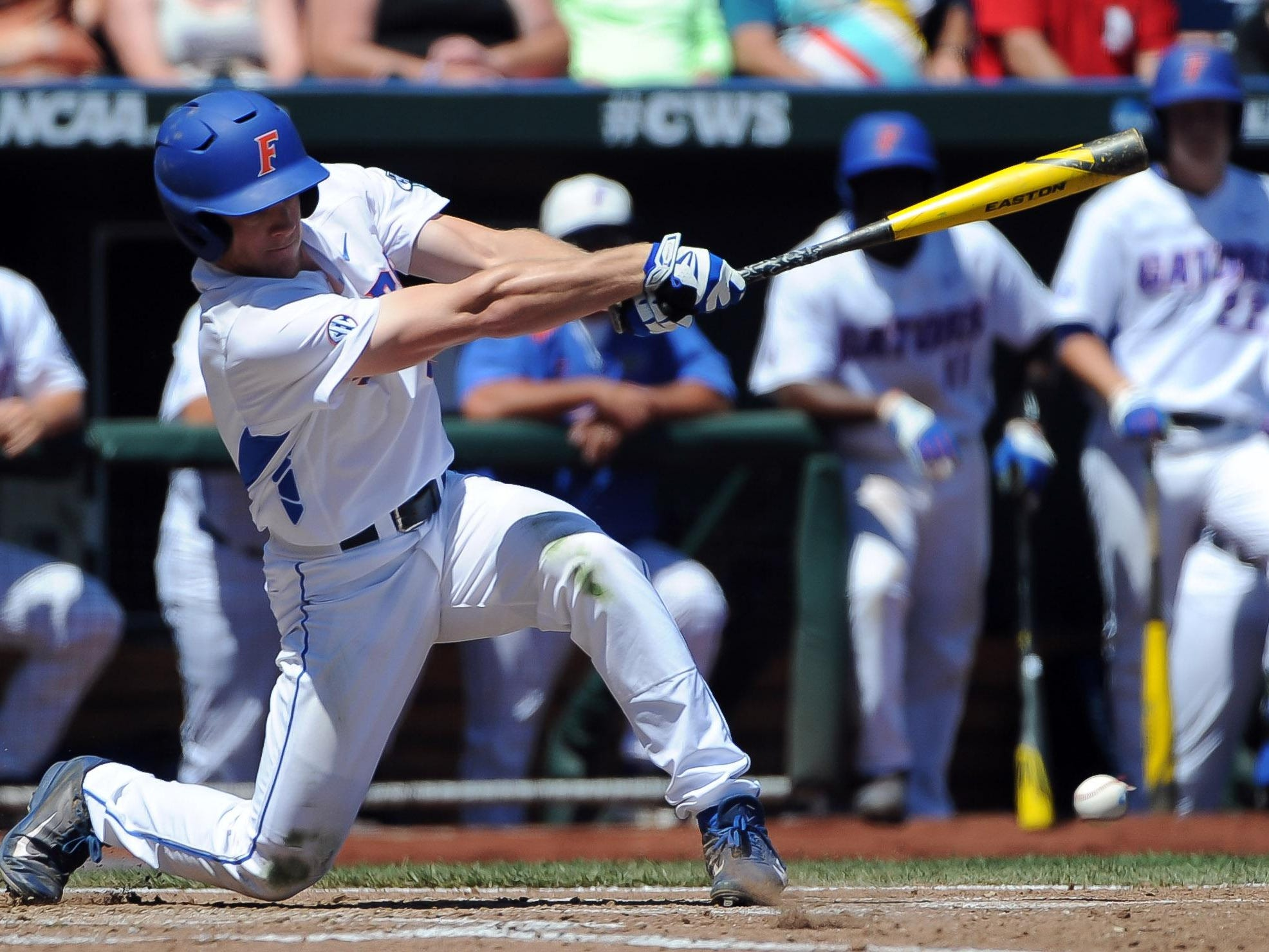 Florida Gators outfielder Harrison Bader (8) drives in the first run in the third inning against the Virginia Cavaliers in the 2015 College World Series at TD Ameritrade Park.