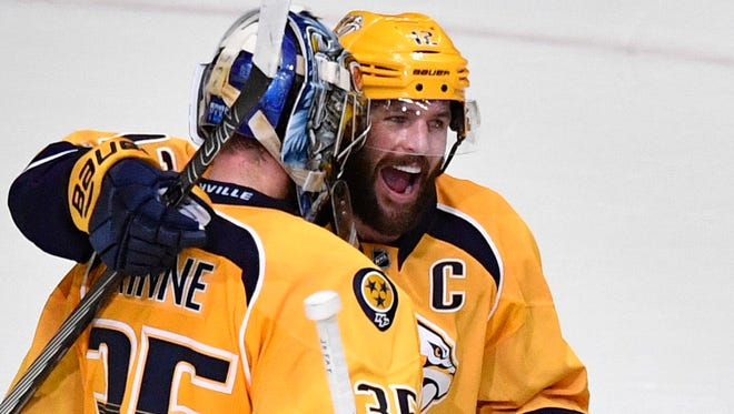 Predators goalie Pekka Rinne is congratulated by center Mike Fisher after the team won Game 3 of the Stanley Cup Final.