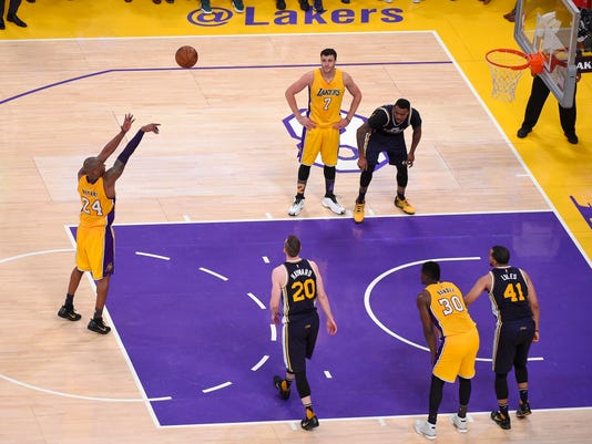 Los Angeles Lakers forward Kobe Bryant shoots a free throw for his last shot of the night during the Lakers' NBA basketball game against the Utah Jazz, Wednesday, April 13, 2016, in Los Angeles. Bryant scored 60 points in his final NBA game as the Lakers won 101-96. (AP Photo/Mark J. Terrill)