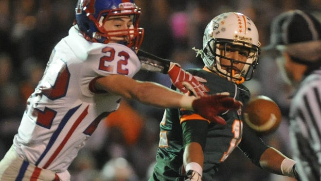 Madison's Sam Cauthren breaks up a pass intended for Chazz Surratt during a 2012 game in Denver, N.C.
