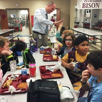 Station Camp Elementary Principal Adam Cripps visits with students during lunch at School on Tuesday, Feb. 2, 2016 in Gallatin.