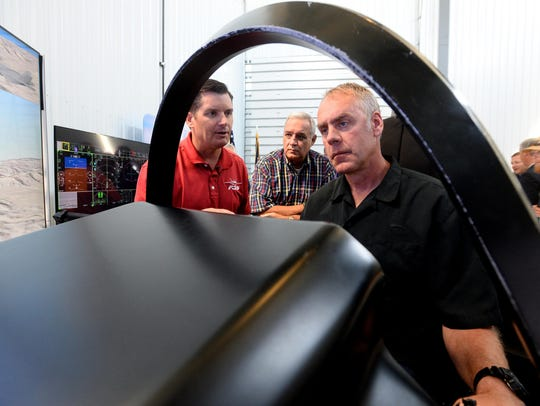 Rep. Ryan Zinke sits in a cockpit demonstrator for