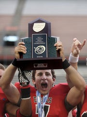 Former NFC quarterback Matt Dobson hoists a state football championship trophy in 2011 after a 69-0 win over Admiral Farragut. Dobson is entering his senior year at Georgia Southern as a starting safety.
