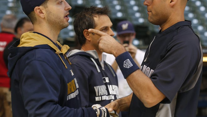 The Brewers' Ryan Braun, left, talks with the Yankees' Derek Jeter before their  game Saturday in Milwaukee. Neither player was in the starting lineup.