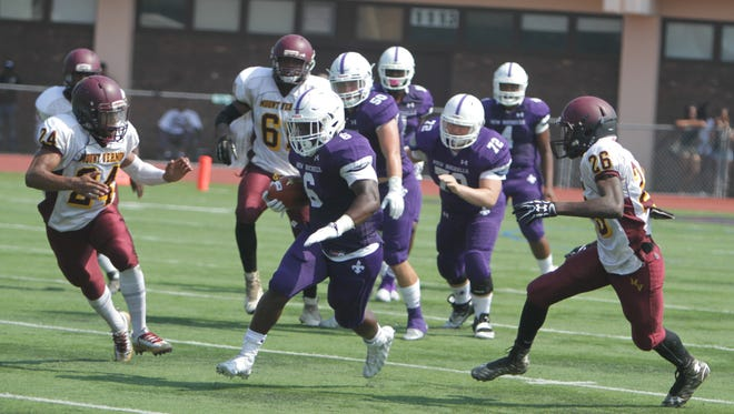 New Rochelle running back Jared Baron (6) runs past the Mount Vernon defense during a Section 1, Class AA football game between New Rochelle and Mount Vernon at New Rochelle High School on Sept. 10th, 2016. New Rochelle won 40-6.