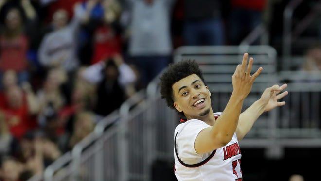 Louisville's Jordan Nwora celebrates after knocking down a three.