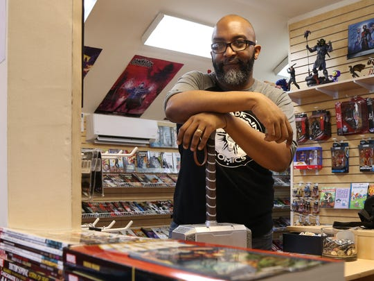 Jean Michel inside his comic store, Megabrain Comics, in the Village of Rhinebeck on April 6, 2018.