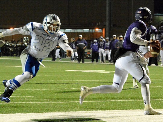 Carlsbad junior defensive end Isaiah Perez chases after