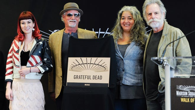 Musicians Bill Kreutzmann, second left, and Bob Weir, right, of the Grateful Dead are joined by Reya Hart, left, and Trixie Garcia, representing their fathers Mickey Hart and Jerry Garcia, at the Madison Square Garden 2015 Walk of Fame Induction ceremony on Monday, May 11, 2015, in New York.