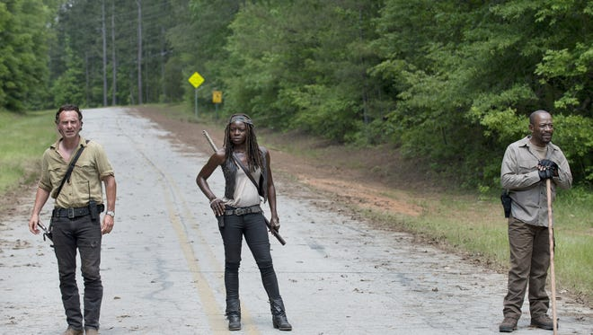 "Andrew Lincoln as Rick Grimes, Danai Gurira as Michonne and Lennie James as Morgan Jones in ""The Walking Dead."""