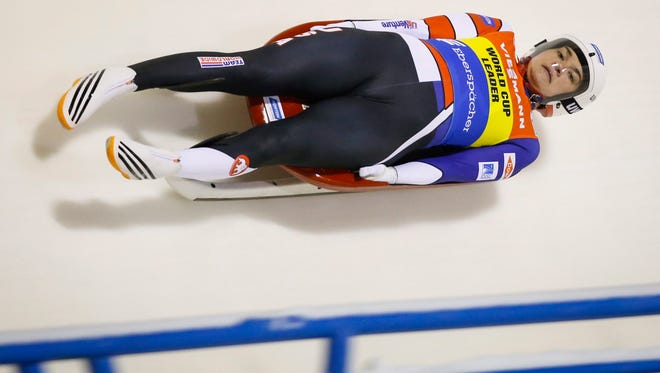 Summer Britcher, of the United States, races down the track during the women's World Cup luge race in Calgary, Alberta, Friday. Britcher placed third Friday but won gold Saturday. She has won medals in her last five World Cup races, including three golds in four races.