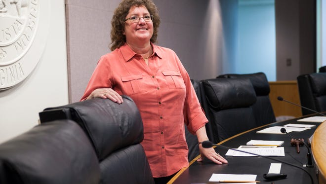 Carolyn Bragg stands for a portrait inside their board room at the Government Center in Verona.