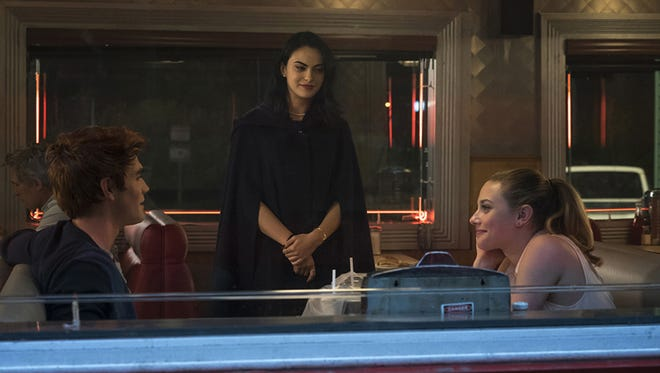 "Archie (KJ Apa, from left), Veronica (Camila Mendes) and Betty (Lili Reinhart) square off in ""Riverdale."""