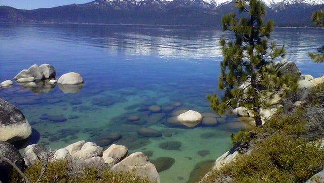 This file photo shows Lake Tahoe seen from Incline Village, Nev. An annual report on Lake Tahoe said the United States' largest alpine lake is still warming at 14 times the historic average.