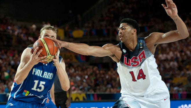 United States's Anthony Davis, right,  duels for the ball beside Finland's Antero Lehto, during the Group C Basketball World Cup match between United States and Finland,  in Bilbao northern Spain, Saturday, Aug. 30, 2014. The 2014 Basketball World Cup competition will take place in various cities in Spain from Aug. 30 through to Sept. 14.