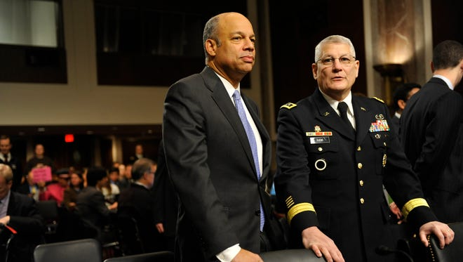 Honorable Jeh C. Johnson, General Counsel, Department of Defense, on the left.