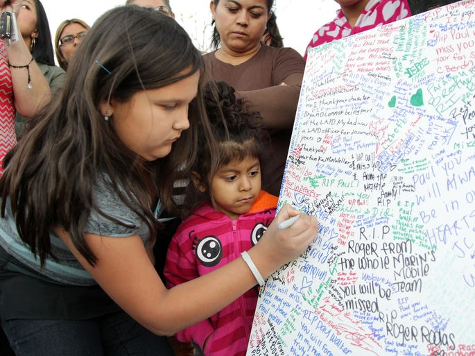 Fans pay tribute to actor Paul Walker at the site of his fatal car accident in Santa Clarita, Calif.  Walker died on November 30, 2013, at age 40.