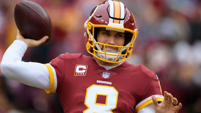 Washington Redskins quarterback Kirk Cousins (8) warms up before an NFL football game against the Denver Broncos in Landover, Md., Sunday, Dec 24, 2017. (AP Photo/Nick Wass)