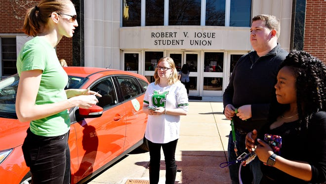 Evva Comans, left, with Zipcar, talks about the features of using the service while York College students Erika Faloney, Ryan Taphouse and Briana Derrick look on as York College launches their partnership with Zipcar on the patio of Iosue Student Union at the college in York, Wednesday, March 9, 2016. Faloney first brought the idea to College President Gunter-Smith last fall, as Faloney and her mother regularly use the service in Baltimore City. Dawn J. Sagert photo