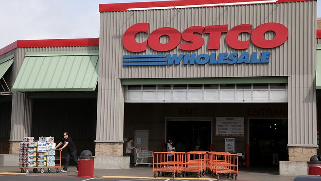 A customer leaves a Costco store March 6, 2014, in Richmond, Calif.