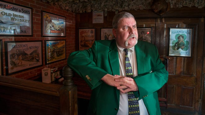Assistant general manager Perry Hunter talks about his father who was a Blue Angels pilot and the Blue Angels memorabilia that they have collected at McGuire's Irish Pub in Pensacola on Monday, October 30, 2017.  McGuire's will soon be creating rooms, including converting the Whiskey Room, that will be display this collection.