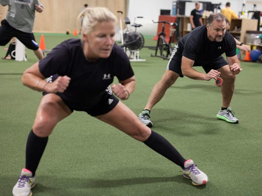 Cathy and Kevin Kansman warm up before their workout at Triad Performance Training Center in Farmington Hills.