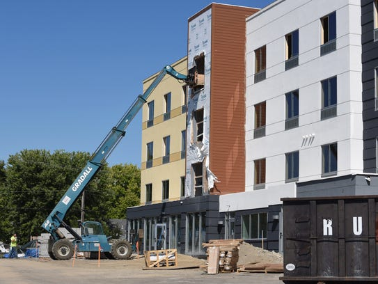 A crew works on the new Fairfield Inn & Suites Tuesday