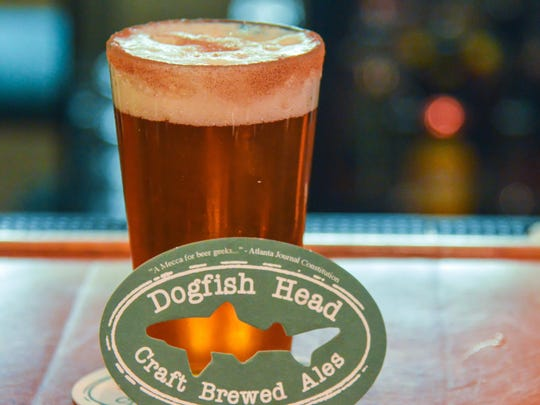 A pint of The Great Pumpkin at Dogfish Head in Rehoboth. This drink is a mixture of Dogfish Head Pumpkin Ale and a shot of vanilla vodka. Finished with a sugar cinnamon rim.