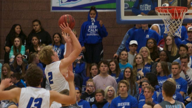 Carson Bottema shoots against Canyon View on Wednesday.
