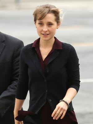 Allison Mack, seen here attending a hearing on Friday, will be confined to her parents' California home until she stands trial on sex-trafficking charges beginning Oct. 1.