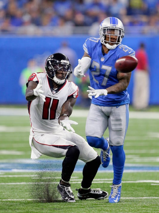 Detroit Lions free safety Glover Quin (27) intercepts a pass intended for Atlanta Falcons wide receiver Julio Jones (11) and returns it 37-yards for a touchdown during the first half of an NFL football game, Sunday, Sept. 24, 2017, in Detroit. (AP Photo/Duane Burleson)
