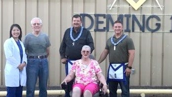 The Masonic Lodge of Deming, NM, along with Dr. Angela Fields of Mimbres Memorial Hospital, teamed up to give away an electric wheelchair to Connie Vanderploeg. The Lodge reached out to Dr. Fields and asked her to find a potential candidate for the chair that was donated a few months prior. Within a few weeks the lodge and Dr. Fields coordinated the giveaway. Pictured from left are: Dr. Angela Fields, Peter Vanderploeg, Secretary RL Stockard, Connie Vanderploeg andJW Rocky Wyrembelski.