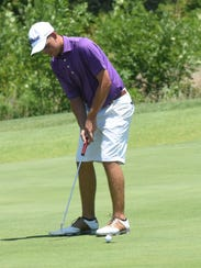 Connor Gaunt of Cabot sinks a short putt to finish