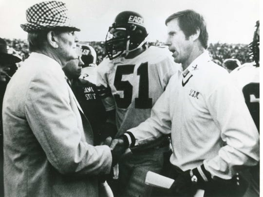 Former Southern Miss coach Jim Carmody, right, shakes