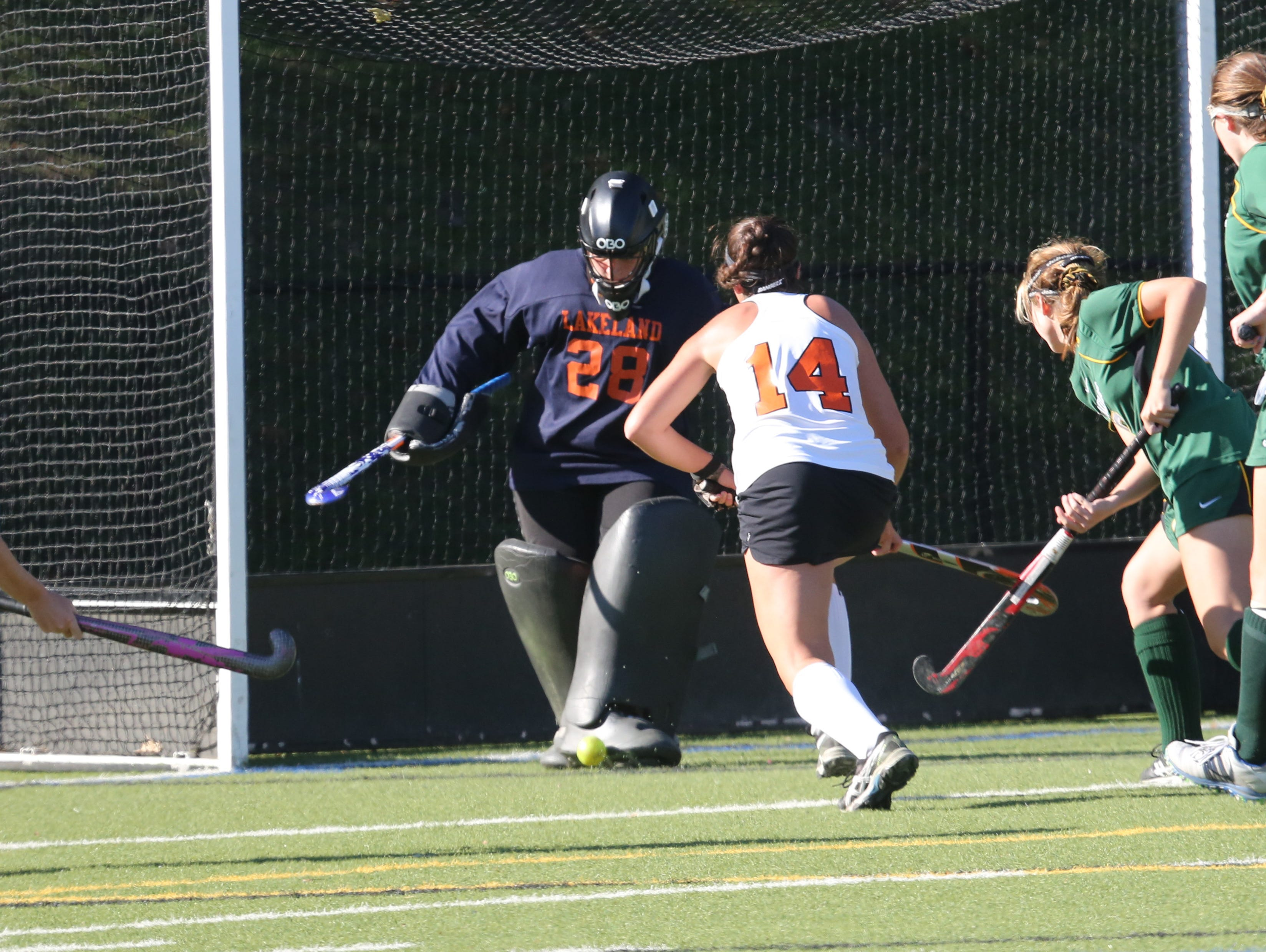 Lakeland goalie Cassie Halpin blocks a shot with Mamaroneck's Sophie Brill bearing down on her during their game at Mamaroneck High School on Saturday.